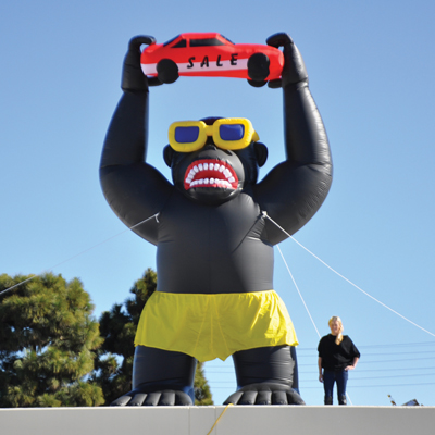 Image result for inflatable gorilla car dealership